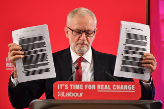 "Labour leader Jeremy Corbyn brandishes documents he says prove the NHS is ""up for sale""."