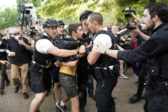 Uniformed US Secret Service police detain a protester in Lafayette Park across from the White House as demonstrators protest the death of George Floyd.