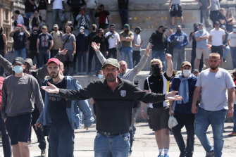 Activists from far-right linked groups chant as they face police officers in Trafalgar Square on June 13.