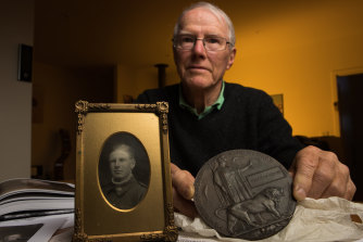 Lest we forget: Sel Glanvill, of Drysdale, Victoria, with a photo and 'dead man's penny' of his teenage uncle, Douglas Wood, who died in World War I.