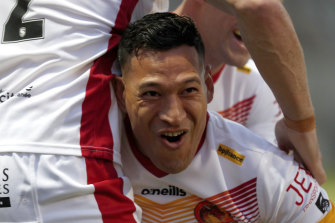 Folau celebrates his try after a lightning-fast start on debut for Catalans.