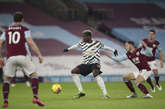 Paul Pogba broke the deadlock at Turf Moor to send Manchester United to the Premier League summit.