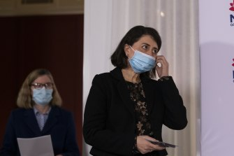 NSW Premier Gladys Berejiklian enters the Tuesday briefing with Chief Health Officer Dr Kerry Chant.