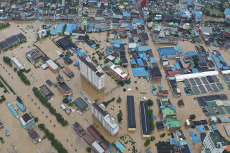 A village area is flooded due to heavy rain in Gurye, South Korea.