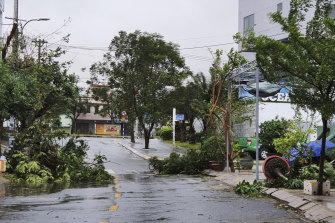 Strong winds brought down tree branches on a deserted street in Da Nang, Vietnam, as typhoon Molave approached on Wednesday.