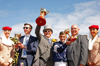 Irish trainer Joseph O'Brien, Australian owner Lloyd Williams and Australian jockey Corey Brown combine to win the 2017 Cup with Rekindling.