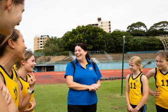 Comonwealth Games gold medallist Kath Sambell describes to her Kambala students a gash she received while training with Cathy Freeman at ES Marks Athletic Field in 1990.