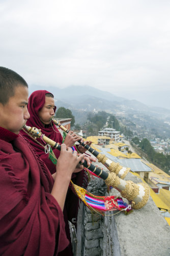 Monks blow temple horns at the Tawang monastery in the Indian state of Arunachal Pradesh. China does not recognise Indian sovereignty over much of this region.