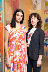 Designer Lisa Gorman with model Domanique Hutchins wearing a dress with artwork from Mangkaja Artists.