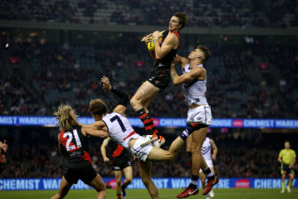 Daniher takes the ball during the round nine against the Fremantle Dockers in May.