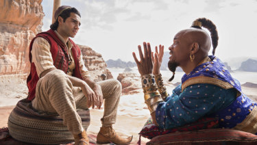 Mena Massoud (left) as Aladdin and Will Smith as Genie in Disney's Aladdin.