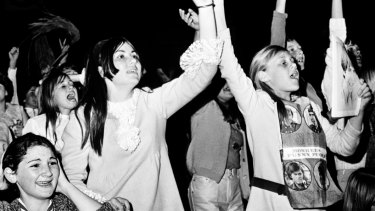 Fans cheer as the Monkees perform at Sydney Stadium on September 21, 1968.