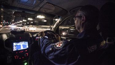 Reverend  Paul McFarlane behind the wheel.