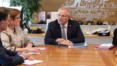 Scott Morrison meets with cabinet members, including Foreign Affairs Minister Marise Payne, on the first work day after his re-election.