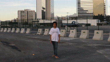 In this May photo, Maria da Penha poses on the exact spot where her house was before she was evicted to make way for Olympics construction.