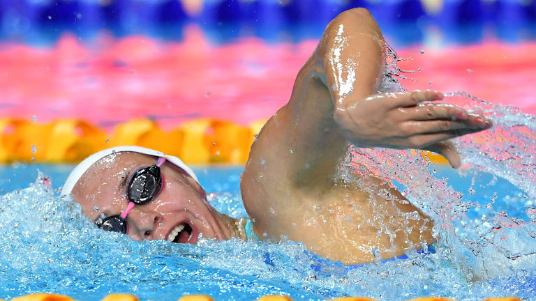 On her own: Ariarne Titmus streaks clear in the 400m freestyle.