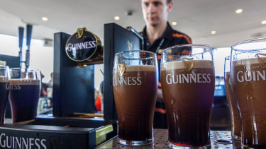Pouring - and waiting for - a pint of Guinness is serious business around the world.