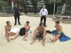 UQ students Lucia Sanchez and Caden Bencz, with US friends Alec Rioux and Trevor Raffin, meet police at South Bank in Brisbane.