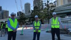 Destination Brisbane project director Simon Crooks, Probuild managing director Jeff Wellburn and Star Casino's Geoff Hogg walk through the concrete base of The Landing, which will become two landscaped parklands reaching 50 metres out into the Brisbane River.