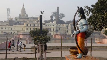 A statue of Hindu god Rama stands beside the River Sarayu in Ayodhya, India.