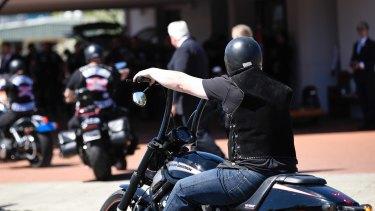 Rebels members arrive to the funeral home to farewell slain bikie boss Nick Martin