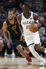 Milwaukee's Tony Snell pushes the ball past Cleveland's Rodney Hood.