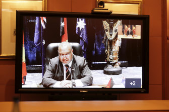 Papua New Guinea Prime Minister James Marape seen on the screen during a virtual summit with Prime Minister Scott Morrison last week.