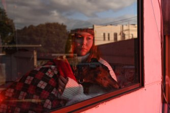 Larisha Taylor's greyhound, Chilli, has been her companion while she bides her time.