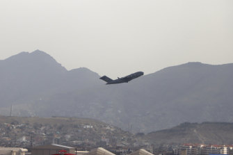 A US military aircraft takes off from the Hamid Karzai International Airport in Kabul, Afghanistan.