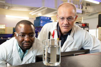 PhD researcher Olawale Oloye (left) and Professor Anthony O'Mullane have developed a method to capture carbon for use in cement.