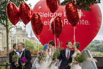 Operation Libero stages a photo opportunity of a marriage with three different couples, in Bern, Sunday, September 26, 2021.