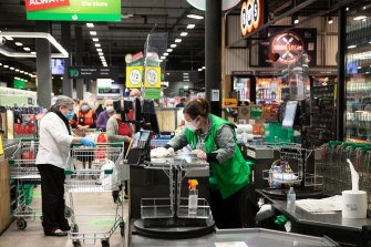 Woolworths is not enforcing mask wearing - but most customers do the right thing.