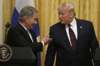 Finnish President Sauli Niinisto shares the stage with Trump.