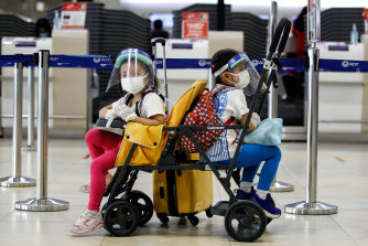 Kids wearing face masks as a preventive measure at Don Muang International Airport during the Coronavirus in Bangkok.