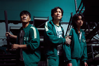 Squid Game is full of players wearing banal teal-green tracksuits, generally speckled with blood and dirt.