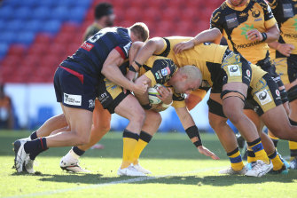 Western Force's Jono Lance is tackled.