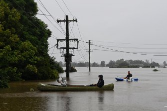 Residents check inundated homes in Windsor as the Hawkesbury River continues to rise on Monday.