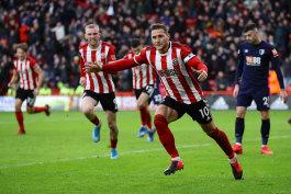 Billy Sharp scores for Sheffield United.