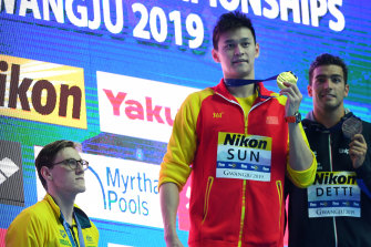 Mack Horton watches Sun Yang during the medal ceremony for the 400m freestyle at the world championships in Gwangju last year.