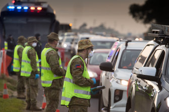 Soldiers and Victoria police on a roadside checkpoint on the Geelong Freeway enforcing lockdown in Melbourne on Friday.
