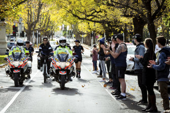 The final group in the relay run down St Kilda Road on Sunday afternoon.