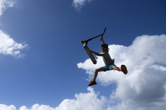 A child scootering at Maroubra skate park on Saturday.