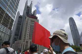 Pro-China supporters hold a placard on their way to protest at the US Consulate in Hong Kong on Sunday, May 31.
