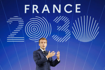 """French President Emmanuel Macron speaks during the presentation of """"France 2030"""" investment plan at the Elysee Palace."""