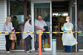 People queue for coronavirus testing at Shepparton Showgrounds.