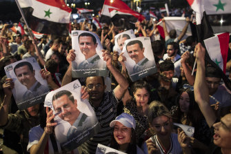 Assad supporters celebrate the results of the national election in Damascus.
