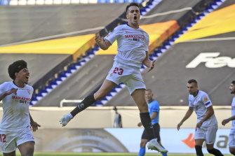 Sergio Reguilon celebrates his first goal for Sevilla in the round-of-16 win over Roma.