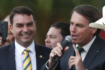 Brazilian Senator Flavio Bolsonaro, left, with his father, President Jair Bolsonaro.