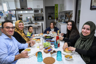 Cengiz and Aylin Altinors with their family  breaking fast together at sundown during Ramadan.