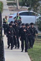Police storm Adelphi Boulevard in Point Cook on Monday following reports of gunshots being fired.